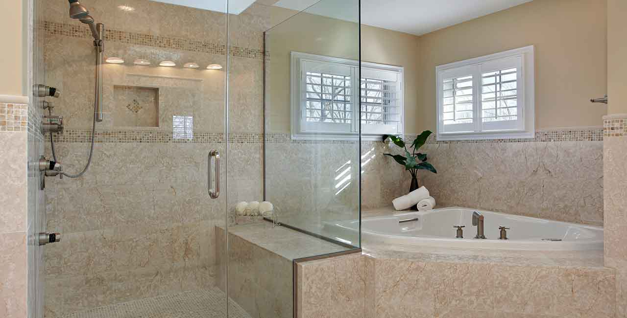Bathroom-with-tan-marble-sunken-tub-glass-shower