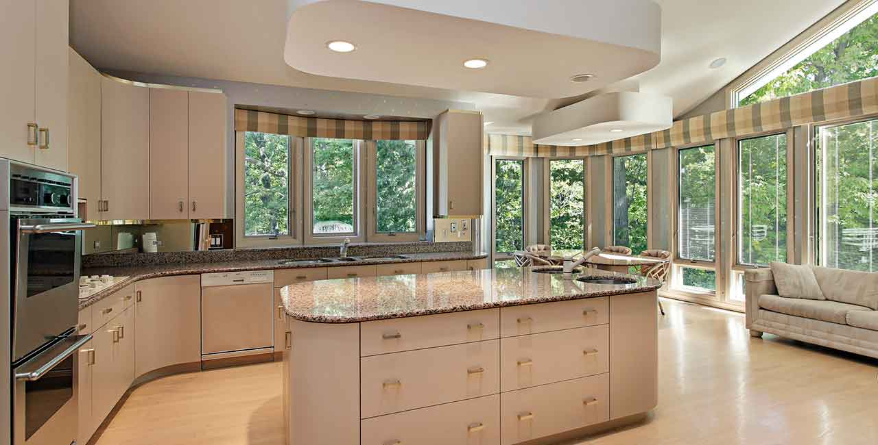 Beige-Kitchen-with-island-and-sculpted-ceiling