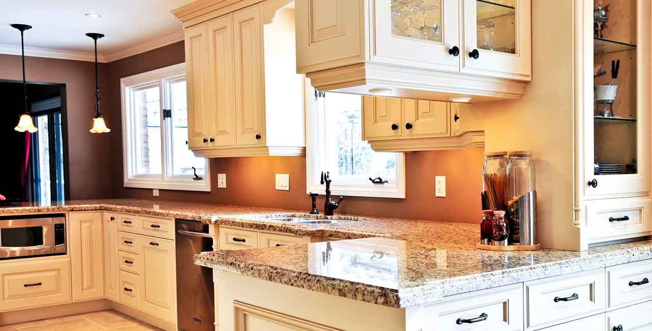 Cream-colored-kitchen-cabinets-with-marble-countertops