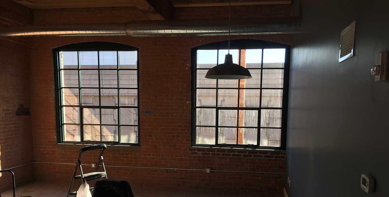 mullioned windows in brick interior