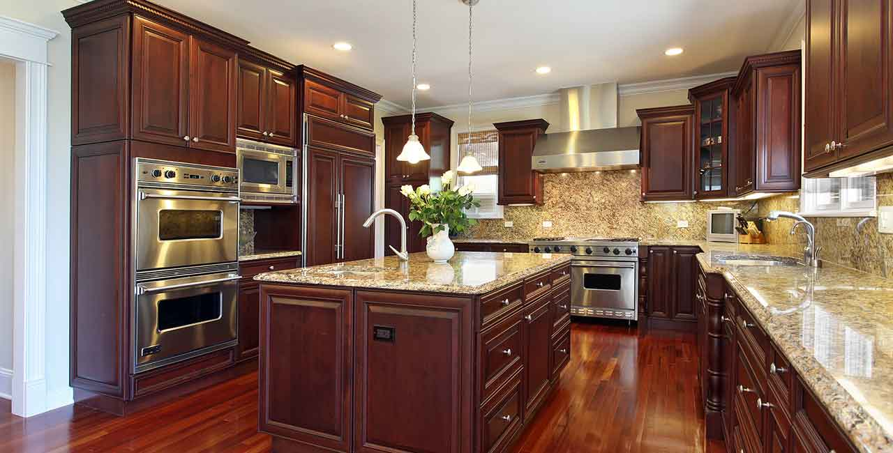 Kitchen-with-cherry-wood-cabinets-and-floor