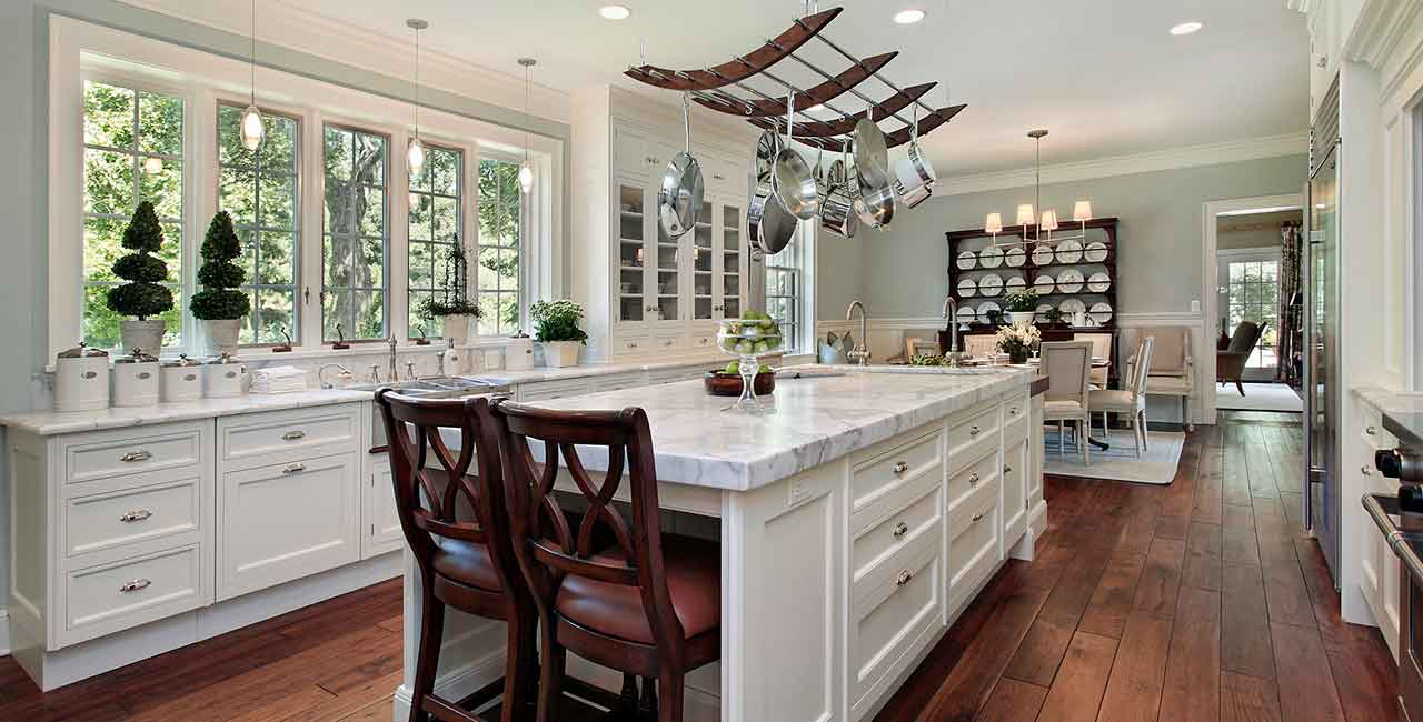 White-kitchen-with-island-and-window-view